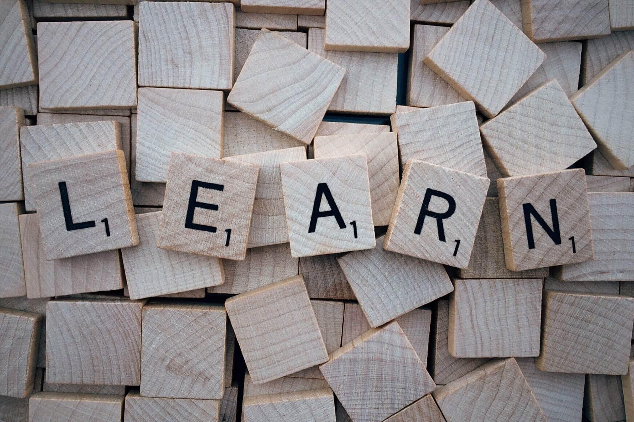 Learn spelt out in wooden scrabble letters