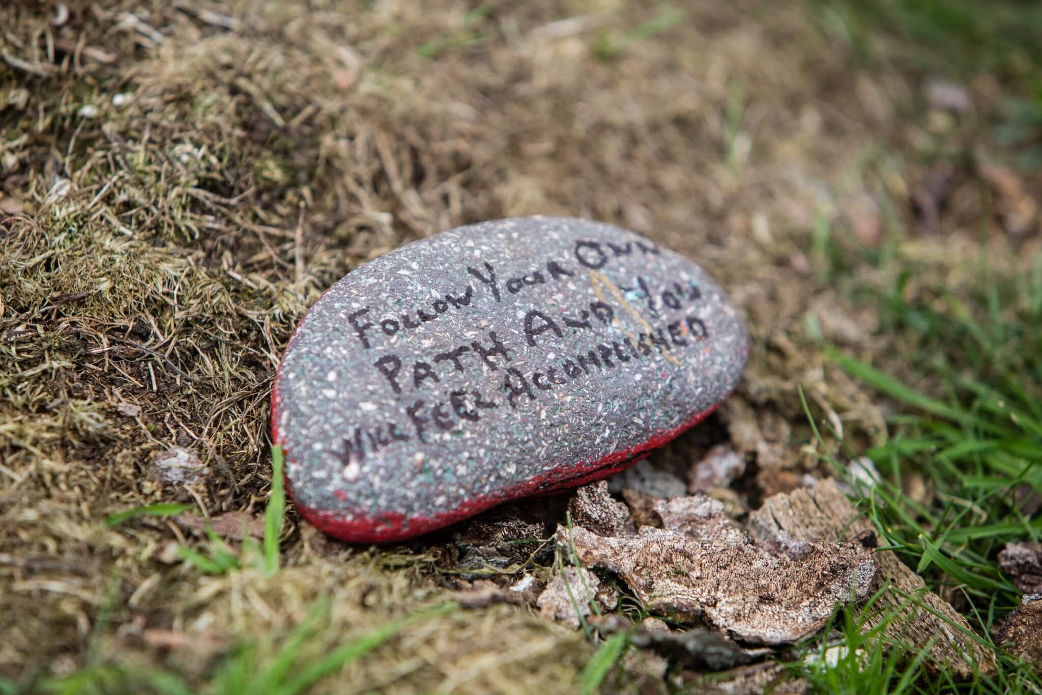 Stone with motivational message painted on