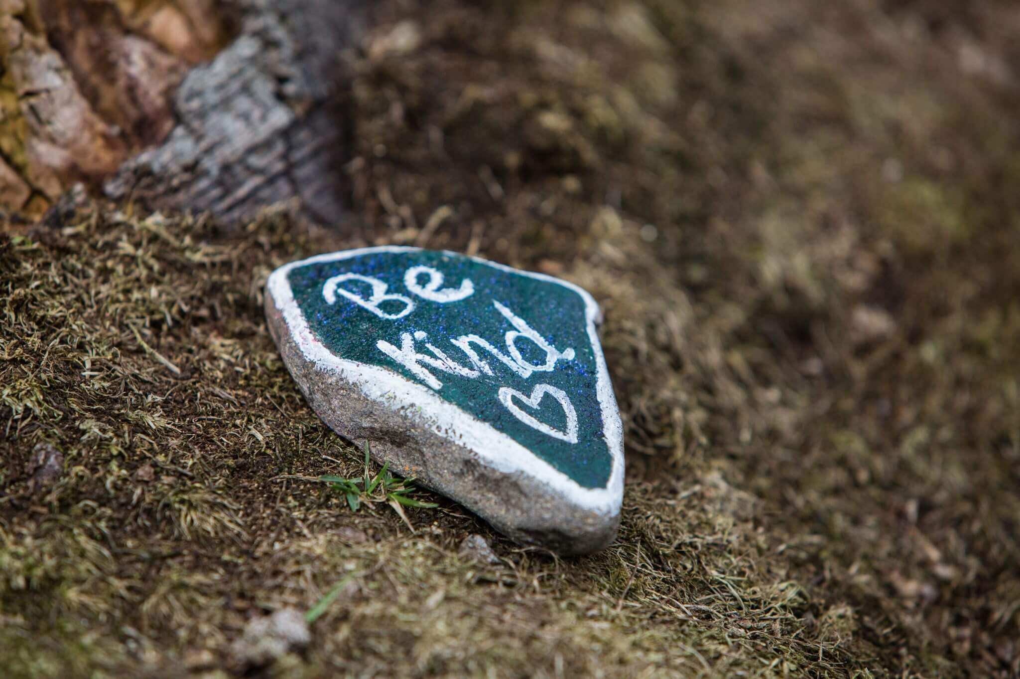 stone with be kind written on it