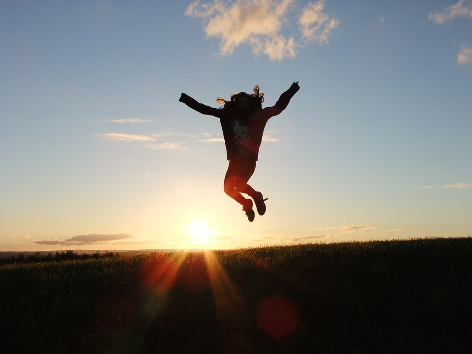 Young person jumping in the air